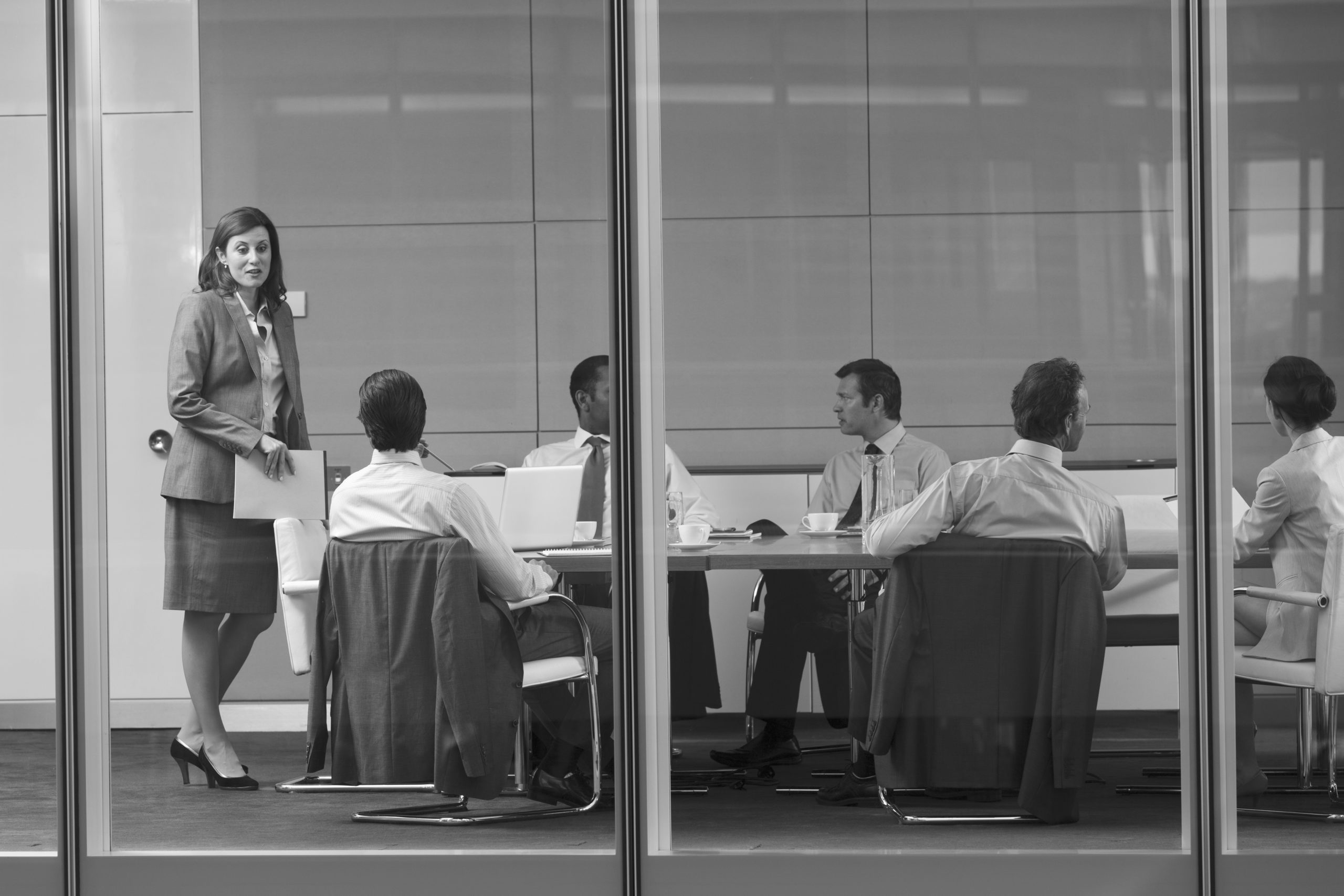 Corporate businesswoman leading conference room meeting