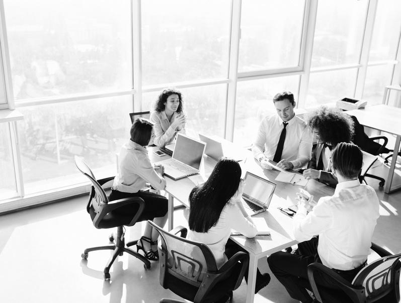 Teamwork in boardroom. Team members having business meeting.