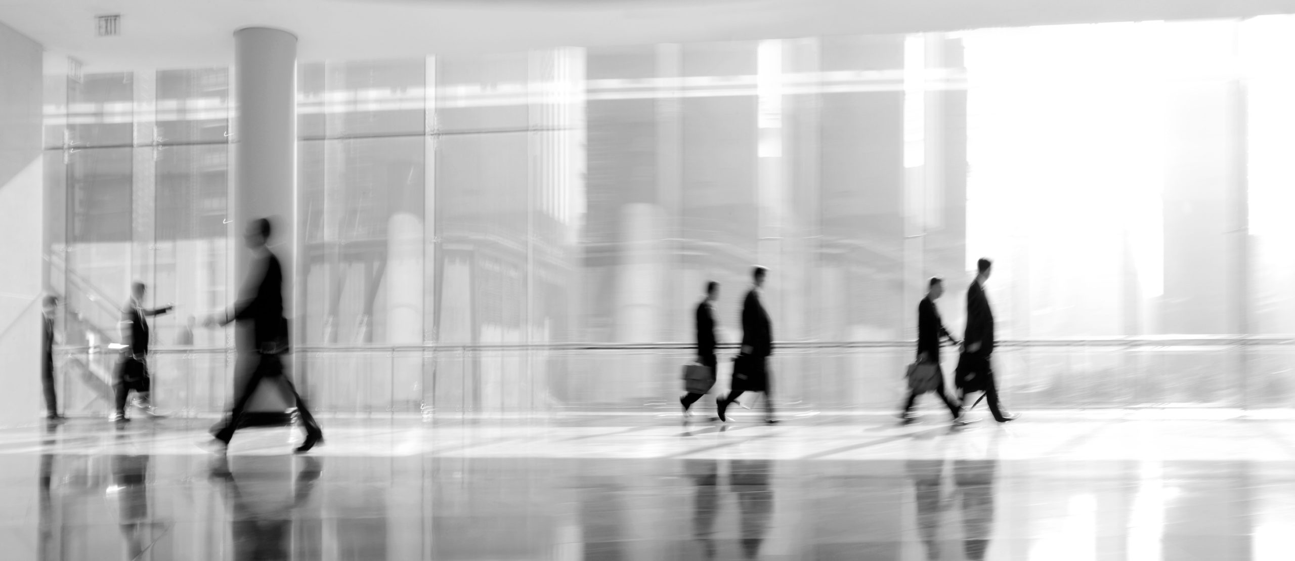 abstrakt image of people in the lobby of a modern business center with a blurred background